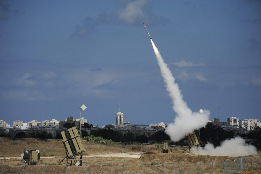 A missile is launched by an Iron Dome battery, a missile defense system designed to intercept and destroy incoming short-range rockets and artillery shells, in the southern Israeli city of Ashdod.