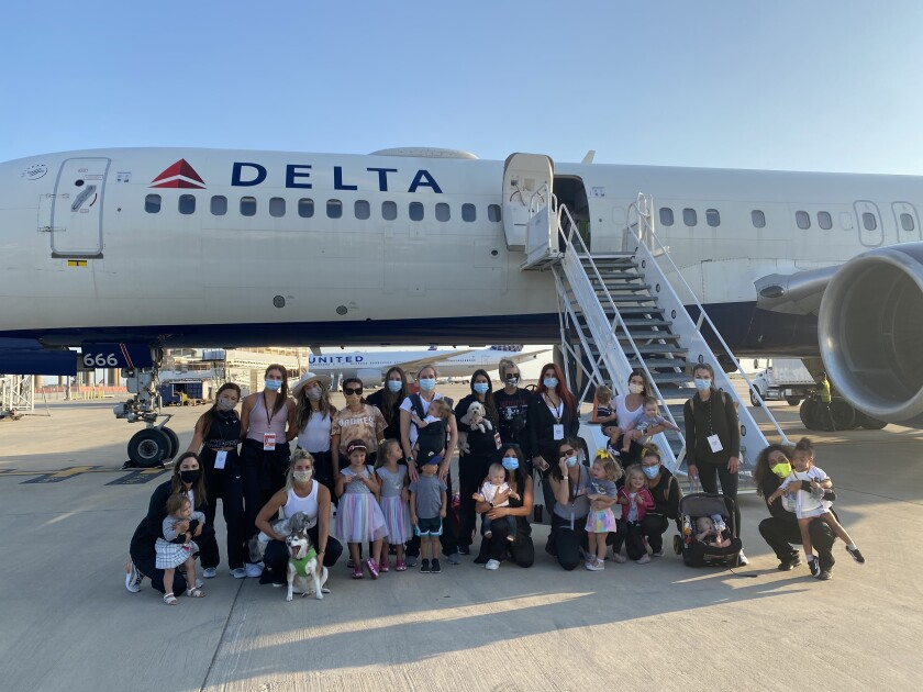 Padres wives, girlfriends and children pose in front of the plane after landing in Texas to be part of postseason bubble.