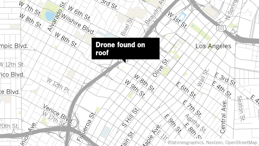A map shows the location where a fireworks-laden drone was found on the roof of a building, police say.