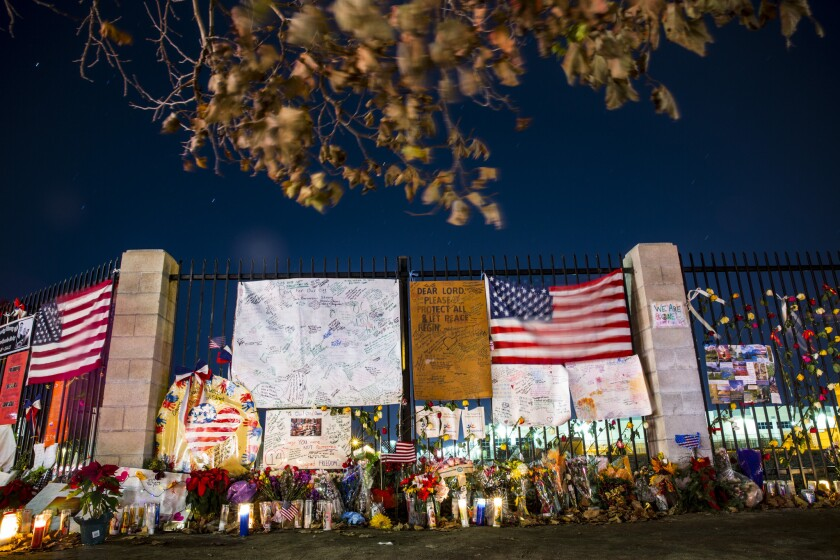 A makeshift memorial sprang up after the the Dec. 2, 2015, terror attack. San Bernardino County officials are formulating plans for a permanent monument to the victims.