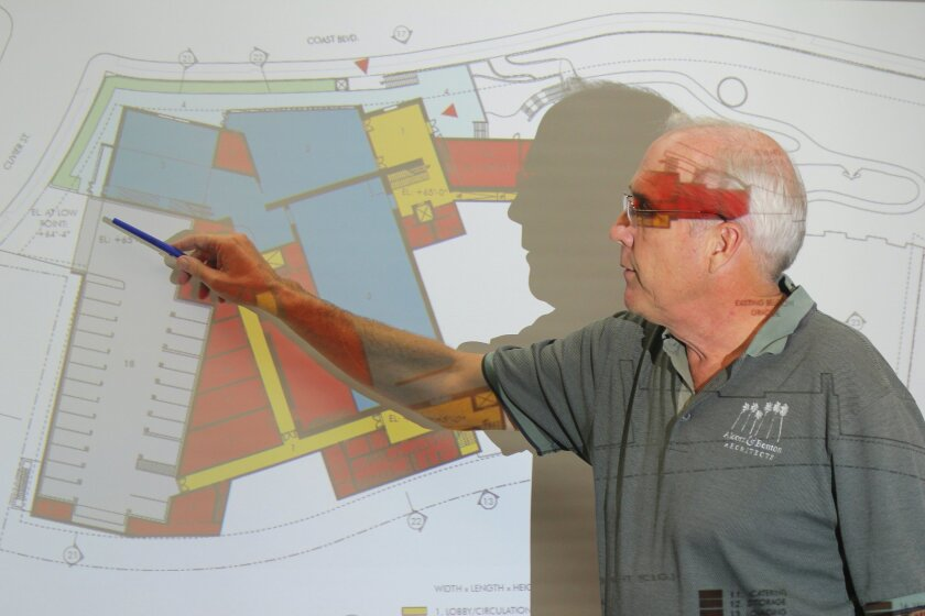 Architect Paul Benton shows the location of a proposed new gallery wing for the Museum of Contemporary Art San Diego on Prosect Street in La Jolla that would include underground parking and improve circulation within the museum for guests.