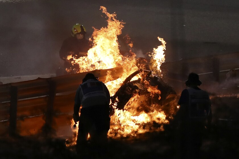 The parts of Haas driver Romain Grosjean's car is burning after he crashed during the Formula One race in Bahrain International Circuit in Sakhir, Bahrain, Sunday, Nov. 29, 2020. (Brynn Lennon, Pool via AP)