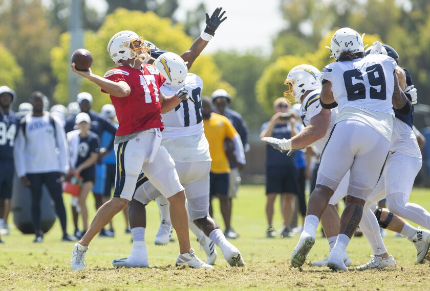 The Chargers' Philip Rivers passes during a joint practice with the Rams on Thursday.