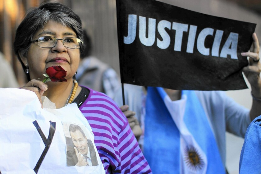 Demonstrators rally at the Buenos Aires funeral of Argentine prosecutor Alberto Nisman in 2015.