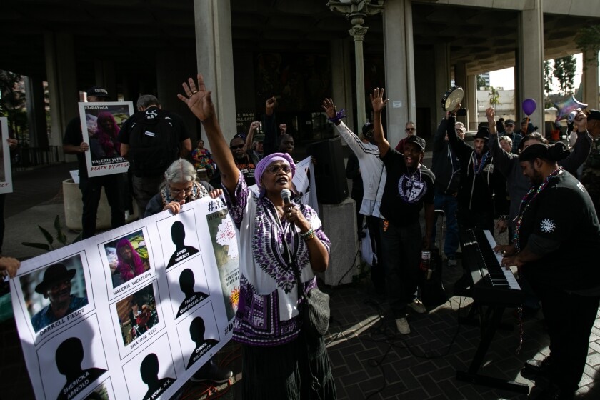 Lorraine Morland speaks and sings to a crowd of supporters gathered outside City Hall to pay tribute to homeless people who have died this year in Los Angeles.