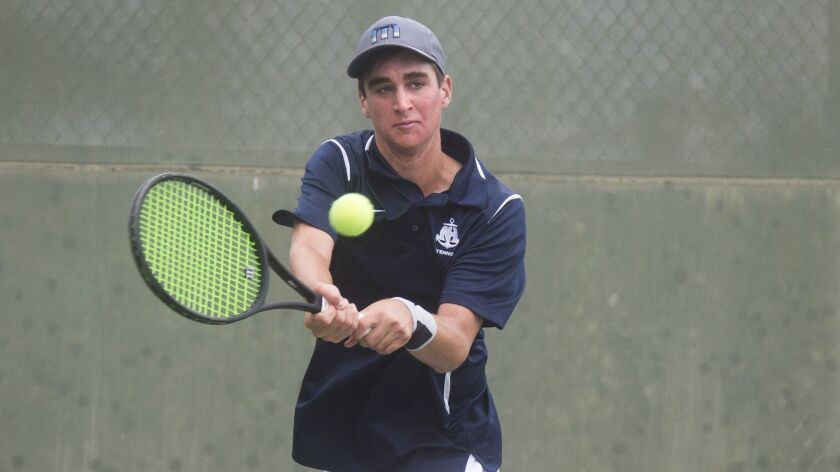 Newport Harbor High's Max McKennon returns a serve during the singles semifinals of the CIF Southern