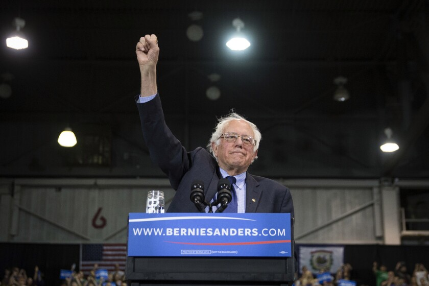 Sen. Bernie Sanders raises his fist to acknowledge the crowd before he speaks during a campaign event at the Big Sandy Superstore Arena on April 26, 2016, in Huntington, W.Va.