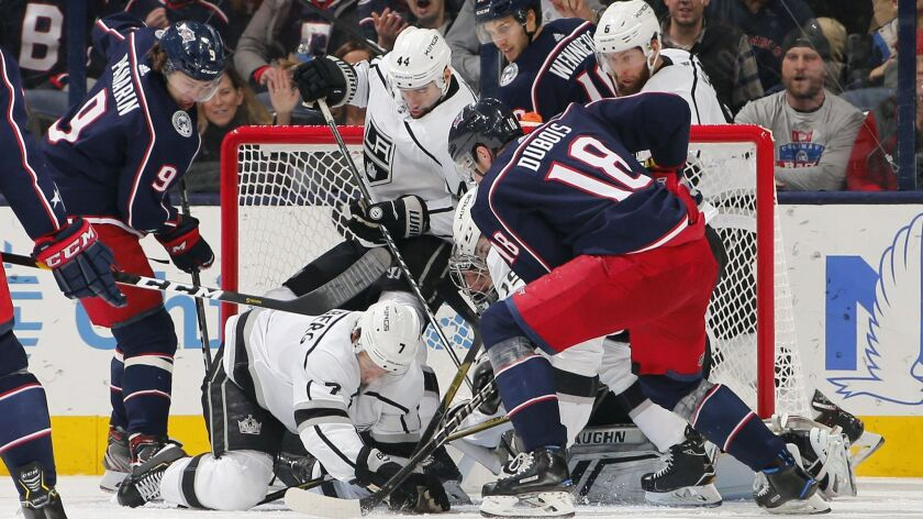 Columbus Blue Jackets' Pierre-Luc Dubois (18) tries to get a shot off on Kings goaltender Jonathan Quick (32) during the second period.