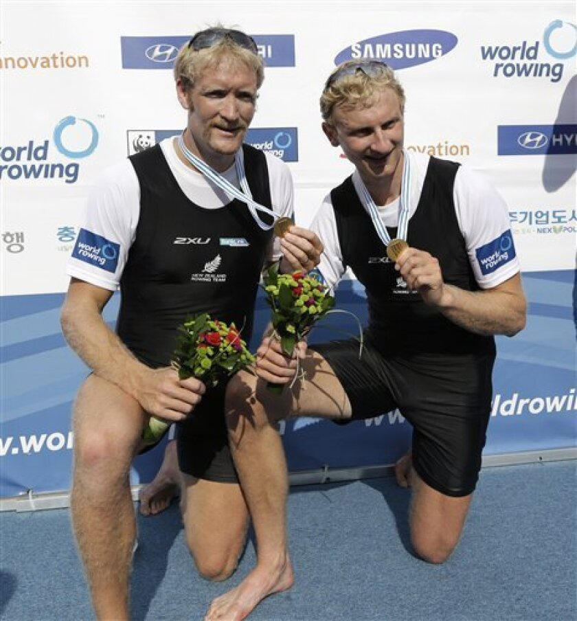 Winners Eric Murray, left, and Hamish Bond of New Zealand pose for the media during a medal ceremony for the men's pair final event of the World Rowing Championships in Chungju, south of Seoul, South Korea, Saturday, Aug. 31, 2013. (AP Photo/Lee Jin-man)