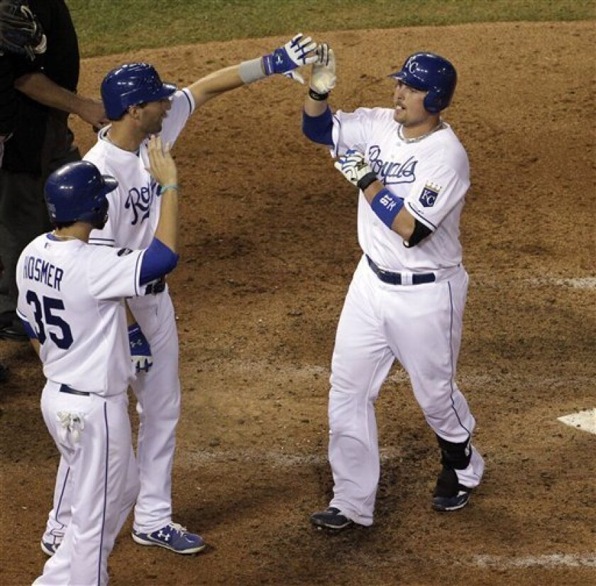 Kansas City Royals' Billy Butler, right, celebrates with teammate Eric Hosmer (35) and Jeff Francoeur after hitting a three-run home run during the eighth inning of a baseball game against the Toronto Blue Jays, Wednesday, June 8, 2011, in Kansas City, Mo. (AP Photo/Charlie Riedel)