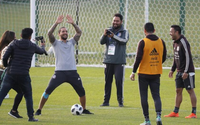 Colombian singer Maluma (C) during a training session of Mexico's national soccer team, two days before the start of the 2018 FIFA World Cup Russia, in Moscow, Russia. EFE