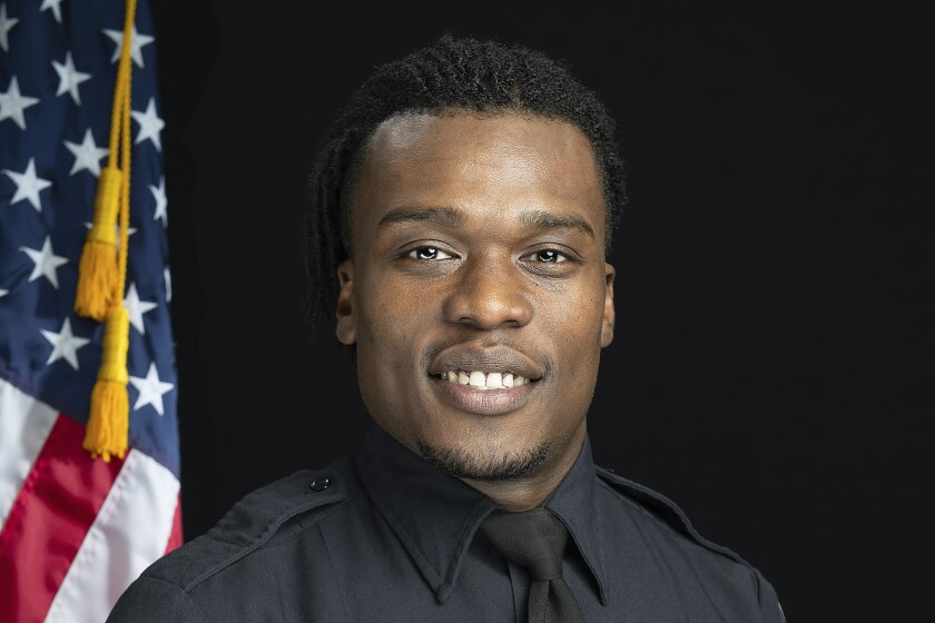 FILE - This undated file photo provided by the Wauwatosa Police Department in Wauwatosa, Wis., shows Wauwatosa Police Officer Joseph Mensah. In a report released Wednesday Oct. 7, 2020, an independent investigator recommended officials in the Milwaukee suburb fire Mensah, who has shot and killed three people in the last five years. (Gary Monreal/Monreal Photography LLC/Wauwatosa Police Department via AP File)