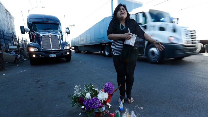 Aileen Kemper stands at the spot where a truck struck and killed her mother, Cynthia Szukala. Prosecutors have declined to file charges.