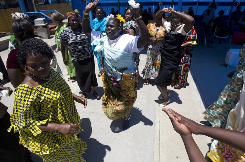 Southern Sudanese celebrate the birth of their new nation, the Republic of South Sudan, at the Southern Sudanese Community Center in City Heights. Photo by Earnie Grafton/The San Diego Union-Tribune.  Copyright 2011 The San Diego Union-Tribune, LLC.