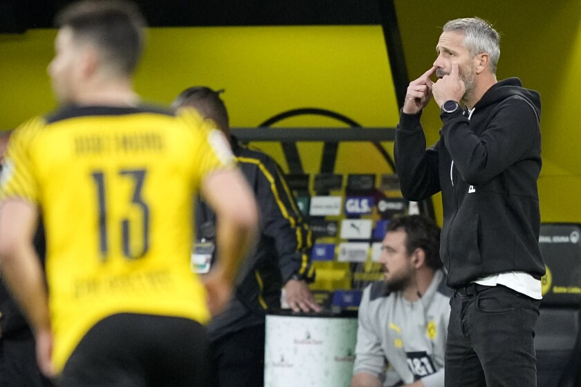 Dortmund's head coach Marco Rose gives indications to his players during the German Bundesliga soccer match between Borussia Dortmund and Union Berlin at the Signal Iduna Park Stadium, in Dortmund, Germany, Sunday, Sept. 19, 2021. (AP Photo/Martin Meissner)