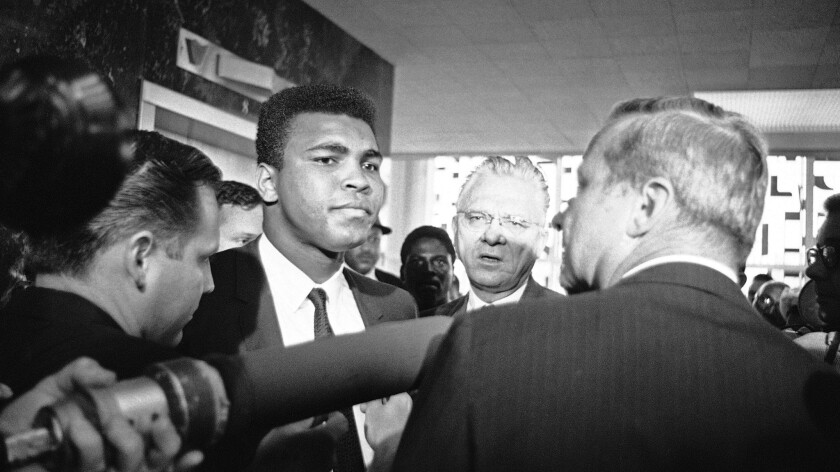 Muhammad Ali with his chief attorney Hayden Covington, right, on June 19, 1967, in Houston, as the boxing champion goes to trial on charges of refusing to be inducted into the armed services.