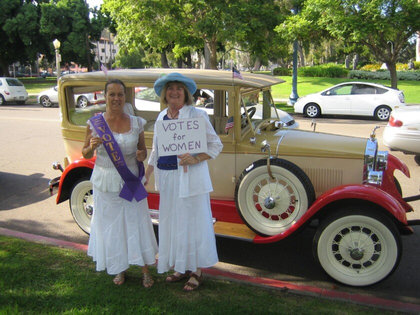 Donna Lilly and Linda Quinby, past presidents of the Del Mar-Leucadia Branch of AAUW, are dressed to celebrate Women's History Month and honor the suffragettes.