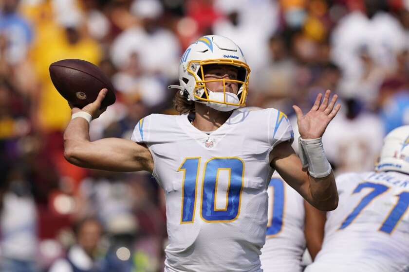Los Angeles Chargers quarterback Justin Herbert (10) throws the ball during the second half of an NFL football game, Sunday, Sept. 12, 2021, in Landover, Md. Herbert threw for 337 yards to beat Washington 20-16. (AP Photo/Andrew Harnik)