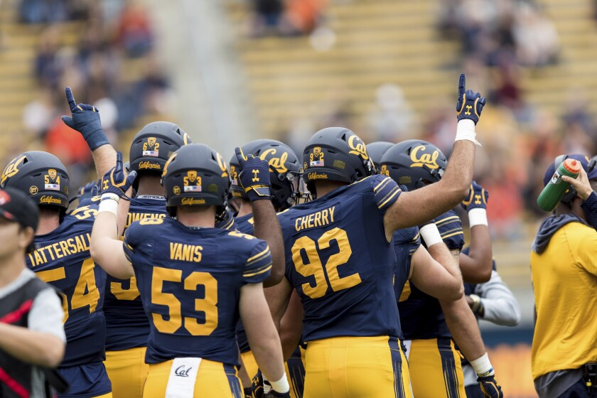 California players celebrate during a break in the third quarter against Oregon State.