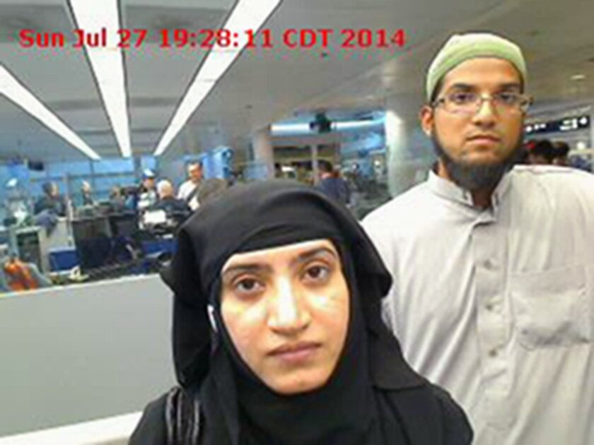 Tashfeen Malik, left, and Syed Farook, as they passed through O'Hare International Airport in Chicago on July 27, 2014. Malik declared her fealty to Islamic State on Facebook before carrying out the attacks that killed 14 in San Bernardino.