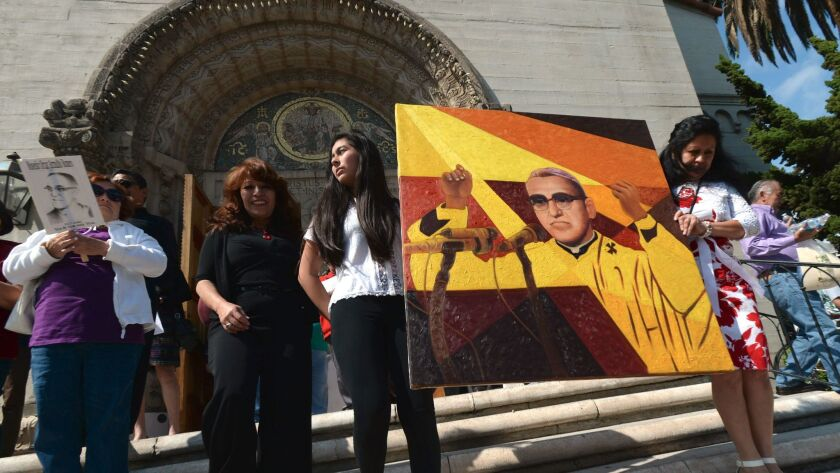 Three items with ties to Salvadoran Archbishop Óscar Arnulfo Romero, pictured here in a painting held by parishioners after his beatification, are available for public viewing Sunday at the Cathedral of Our Lady of the Angels.