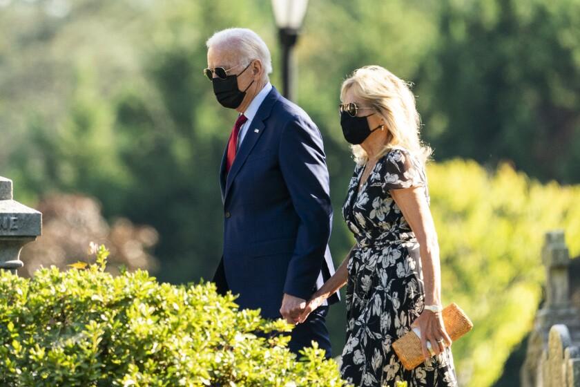 President Joe Biden and first lady Jill Biden leave St. Joseph on the Brandywine Catholic Church in Wilmington, Del., after attending a Mass, Saturday, Sept. 4, 2021. (AP Photo/Manuel Balce Ceneta)