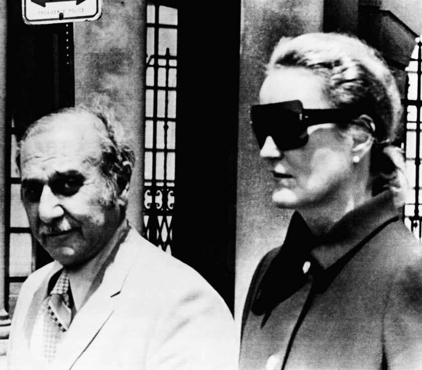 """FILE - In this June 17, 1971 file photo, heiress Doris Duke and her attorney Aram Arabian, leave Superior Court in Providence, R.I. When Duke, the fabulously wealthy tobacco and power company heir, ran over and killed a longtime employee and confidant at her Newport, R.I. mansion in 1966, many people never bought the official police report that the death was an """"unfortunate accident."""" Peter Lance's book """"Homicide at Rough Point"""" released earlier this year concluded that Duke literally got away with murder in the death of Eduardo Tirella. (AP Photo, File)"""