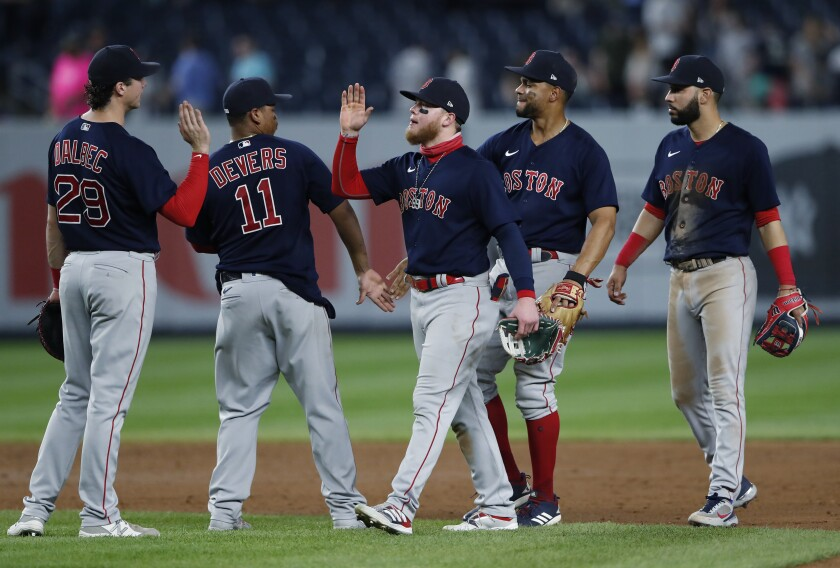 Boston Red Sox center fielder Alex Verdugo, center, celebrates with teammates after the Red Sox defeated the New York Yankees 7-3 in a baseball game Saturday, June 5, 2021, in New York. (AP Photo/Noah K. Murray)