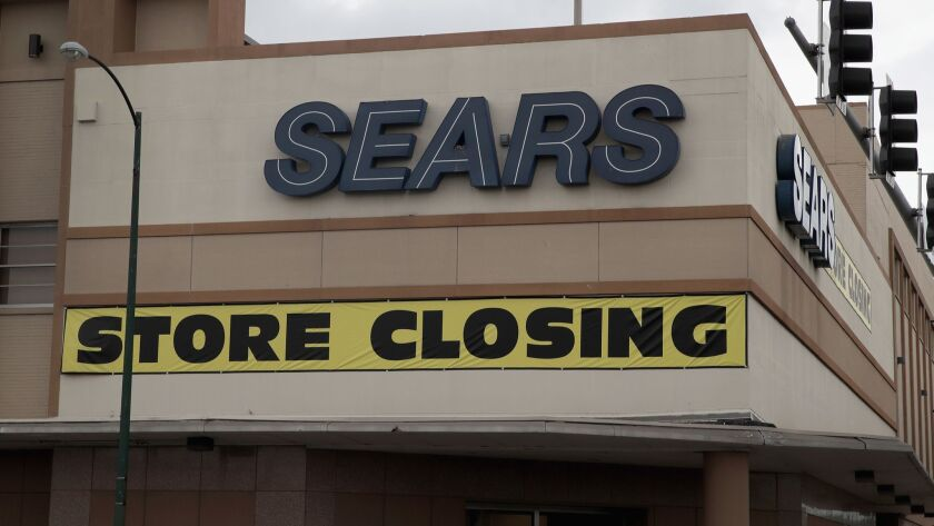 "A Sears store in Chicago bears a ""store closing"" sign in 2017. The company has since announced additional closures."