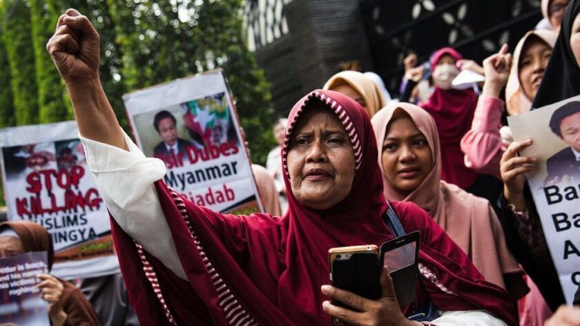A women's group demonstrates outside the Myanmar Embassy in Jakarta, Indonesia, in protest of a crackdown against minority Rohingya Muslims.
