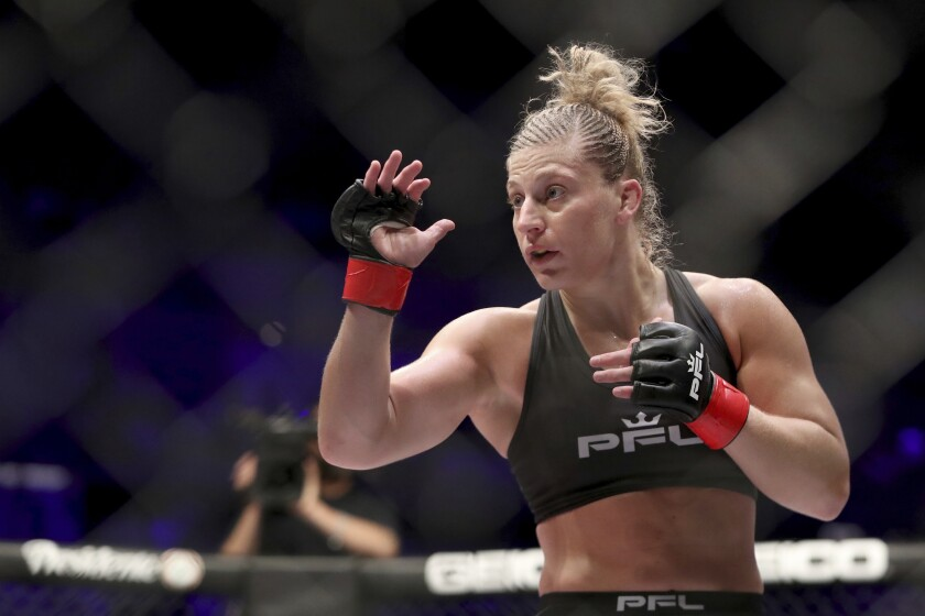 FILE - Kayla Harrison is shown during a PFL (Professional Fighters League) bout against Larissa Pacheco at Nassau Coliseum in Uniondale, N.Y., in this Thursday, May 9, 2019, file photo. Harrison's new bio reads, Olympic gold medalist, MMA champ, single mom. When tragedy struck her family, Harrison suddenly had to balance unexpected single motherhood with a blossoming career as an undefeated fighter for the PFL. Harrison is scheduled to fight against Cindy Dandois on Friday, June 25 in Atlantic City, N.J. (AP Photo/Greg Payan, File)