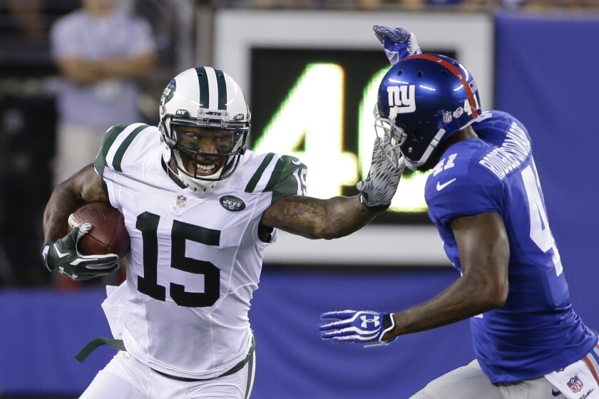 Brandon Marshall (15) tries to fend off Giants defensive back Dominique Rodgers-Cromartie while playing for the Jets.