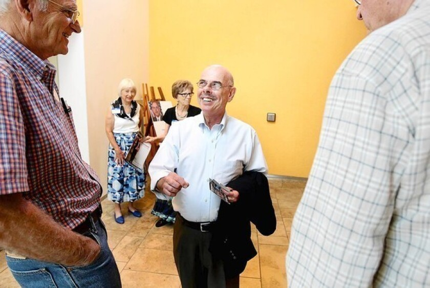 Rep. Henry Waxman, center, mingles with guests after speaking to the Palos Verdes Peninsula Democratic Club.