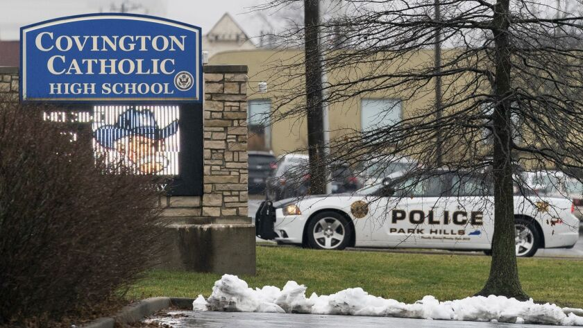 A police car sits at the entrance to Covington Catholic High School in Park Hills, Ky., Saturday, Ja