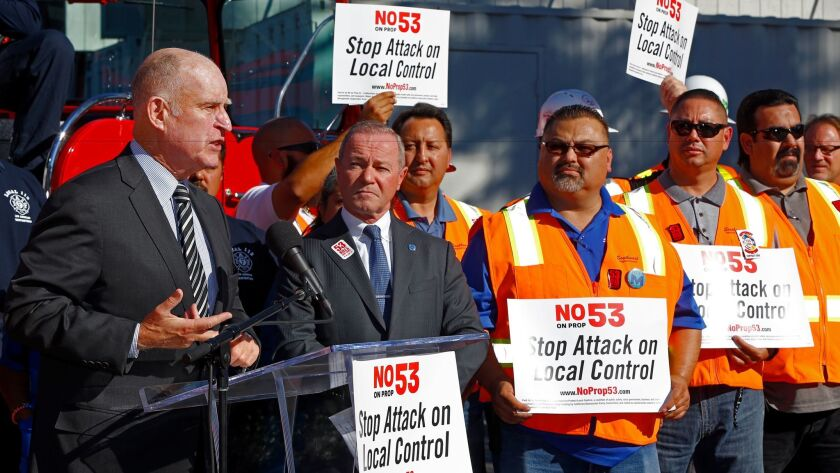 Jerry Brown speaks at a rally against Proposition 53