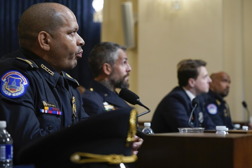 U.S. Capitol Police officers watch a video of the rioters during the House select committee hearing .