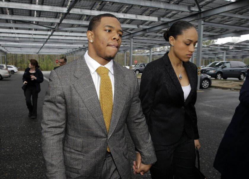 """FILE - In this May 1, 2014, file photo, Baltimore Ravens football player  Ray Rice holds hands with his wife, Janay Palmer, as they arrive at Atlantic County Criminal Courthouse in Mays Landing, N.J. Banter by two """"Fox & Friends"""" hosts about video showing Rice hitting his then future wife is under"""