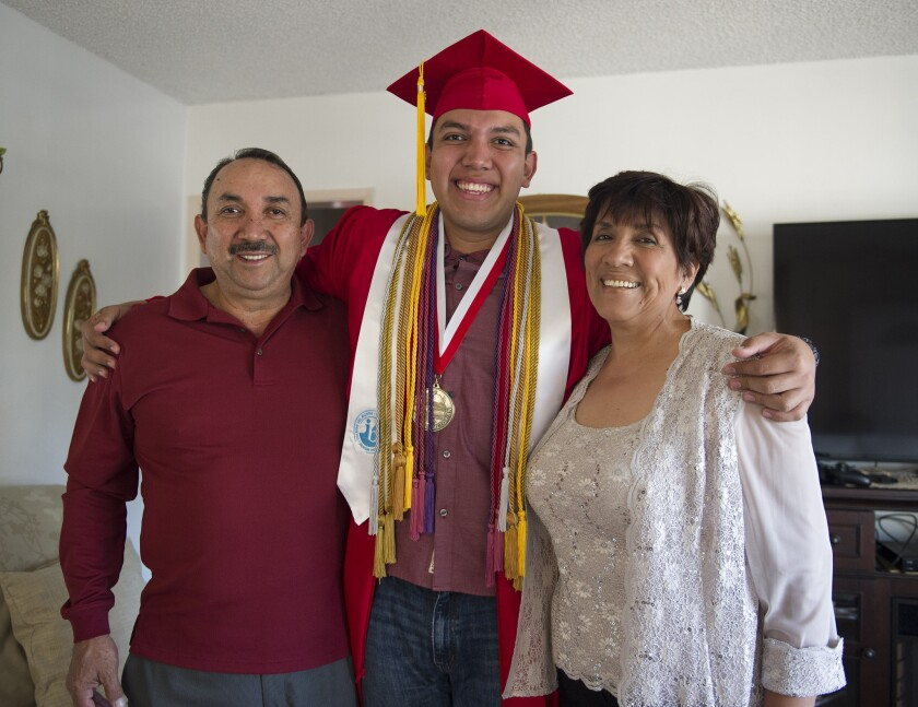 Fernando Rojas, a senior at Fullerton High School, stands with his parents, Raul Rojas and Maria, in Fullerton. Rojas was accepted into all eight Ivy League schools. He is planning on attending Yale University in the fall.