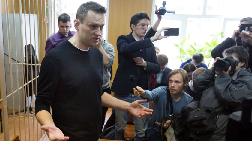 Russian opposition leader Alexei Navalny gestures while speaking in court in Moscow, Russia, Monday,