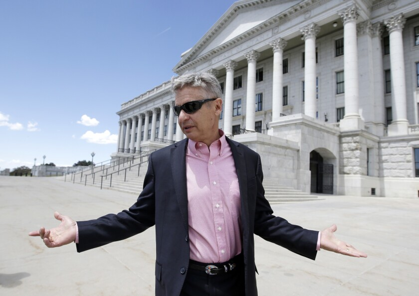Libertarian presidential candidate and former New Mexico Gov. Gary Johnson leaves the Utah State Capitol in Salt Lake City.