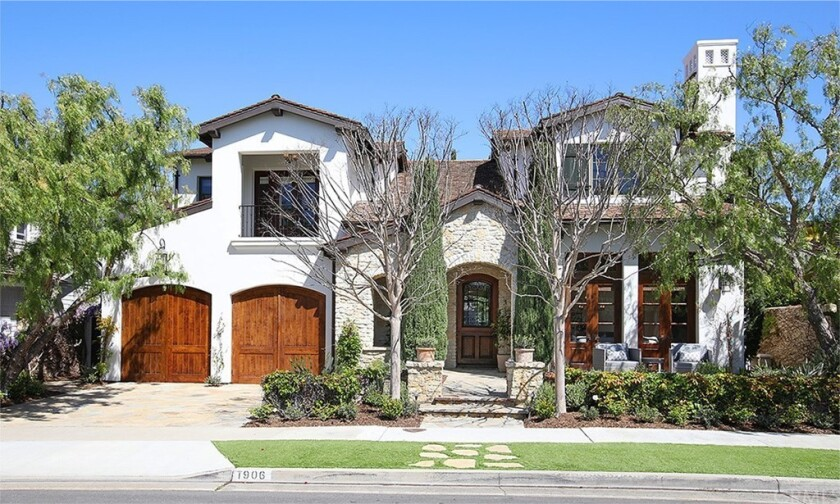 The 3,500-square-foot custom-built home is in Newport Beach's Port Streets community.