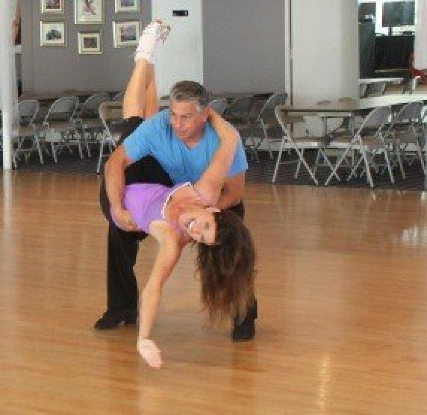 La Jolla resident Lisa D'Angelo takes part in her weekly rehearsal with instructor and dance partner Tony Prado for La Jolla Dancing with the Stars. She says the practices are  'a complete, full-body workout.'