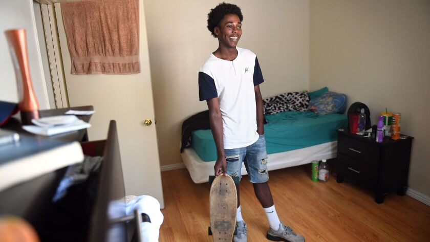 "Eric Usher, seen in his L.A. apartment, is in ""extended foster care,"" which lets 18- to 21-year-olds continue receiving housing, funding and support services."