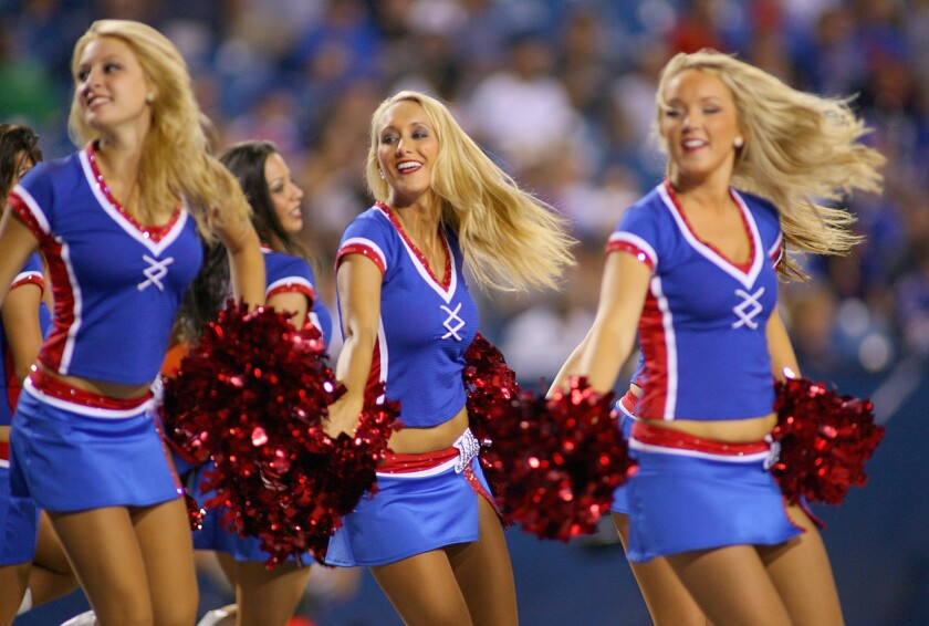 A New York judge on July 1, 2014, refused to toss a wage theft lawsuit filed by five former Buffalo Jills professional cheerleaders against the NFL's Buffalo Bills. Here, members of the 2012 Jills squad perform at a game at Ralph Wilson Stadium in Orchard Park, New York.