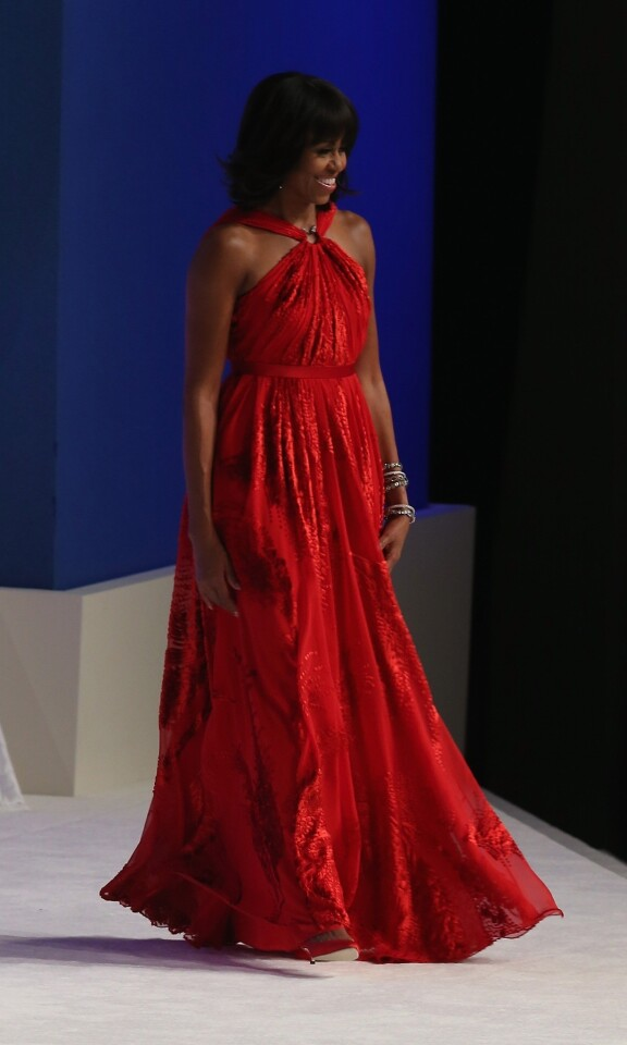 First lady Michelle Obama in a Jason Wu gown, walks on stage during the Commander in Chief Inaugural Ball at the Walter E. Washington Convention Center on January 21, 2013 in Washington, DC.