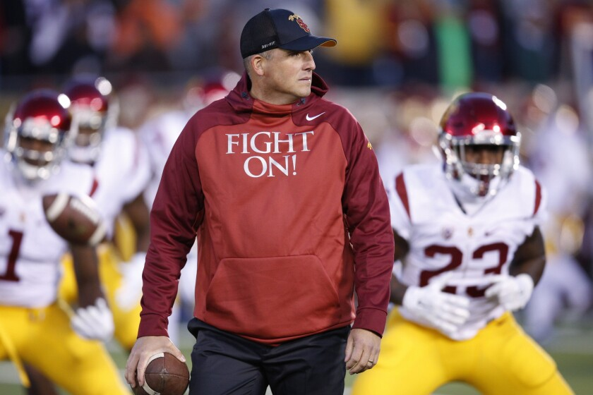 USC Interim Coach Clay Helton gets his team ready before a game against Notre Dame on Oct. 17.