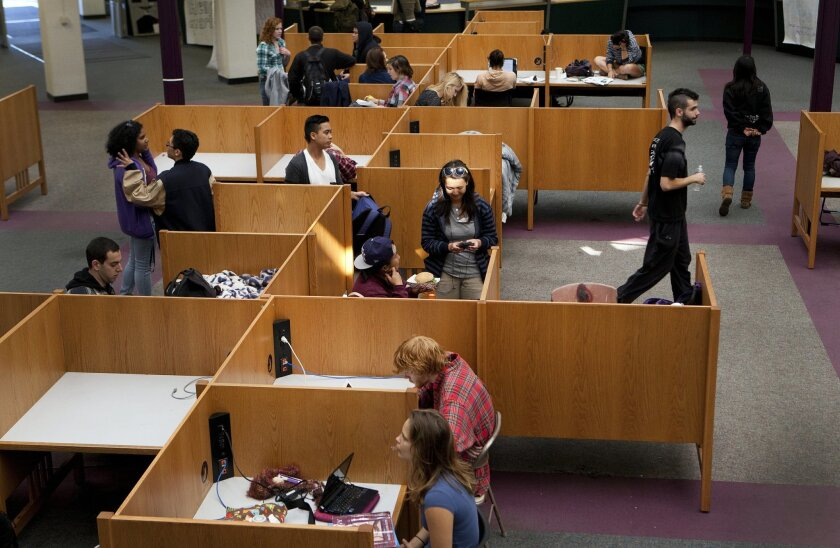 Students at the University of California San Diego study in the former Center for Library & Instructional Computing Services (CLICS), after the doors were forced open Monday morning and they rushed inside.