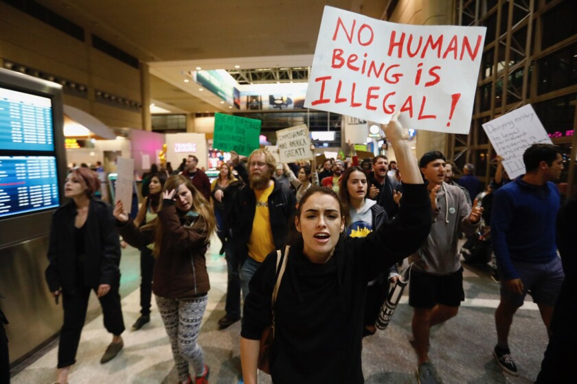 Hundreds march inside the Tom Bradley International Terminal at LAX in January to protest President Trump's immigration order.