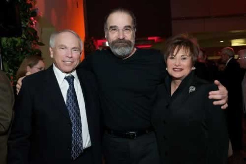 George and Mary Ann Scher with actor/singer Mandy Patinkin (center). Photo by Carol Sonstein