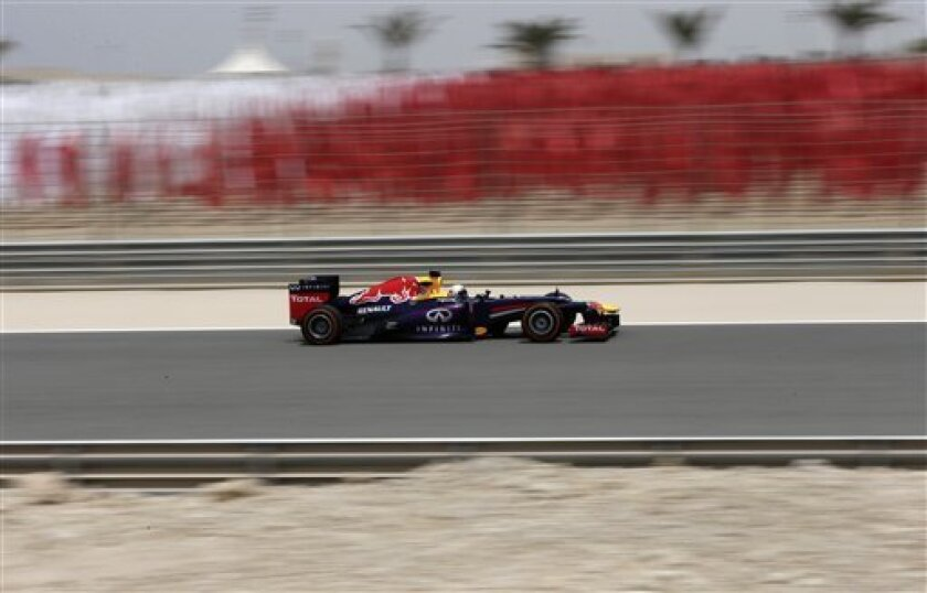 Red Bull driver Sebastian Vettel of Germany steers his car during the first free practice ahead the Bahrain Formula One Grand Prix at the Formula One Bahrain International Circuit, in Sakhir, Bahrain, Friday, April 19, 2013. The Bahrain Formula One Grand Prix will take place on Sunday. (AP Photo/Hassan Ammar)